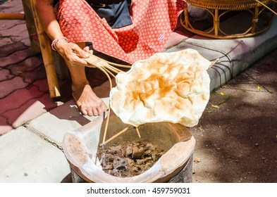 woman Grill Giant Rice Crispy with charcoal fire, The ancient Thai snack combination of rice.