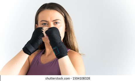 Woman in guard position with boxing wraps or bandages