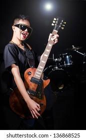 Woman guitar player during concert
