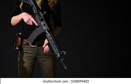 woman with gun in hands
