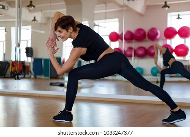 the woman in a gym doing exercises