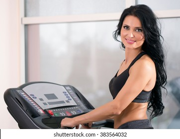 woman at the gym has been running on a treadmill