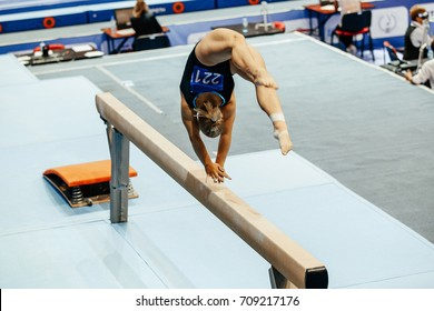woman gymnast acrobatic skill in balance beam gymnastics
