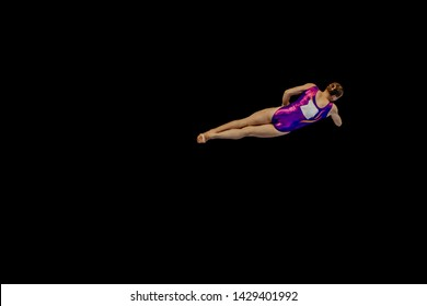 woman gymnast flying in air somersault exercise gymnastics on black background