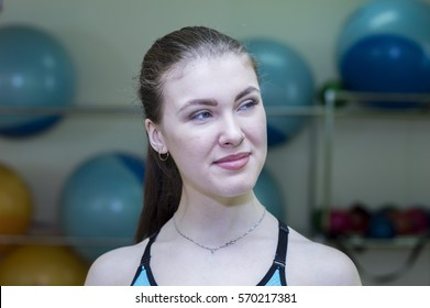 Woman at gymnastic physical training fitness exercise in gym.