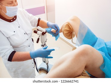 Woman in gynecological chair during gynecological check up with her doctor. Gynecologist examines a woman. Diagnostic, healthcare, medical service