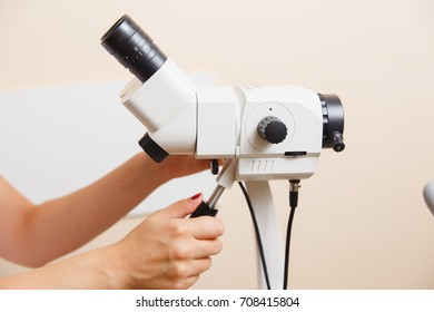 woman gynecologist working with colposcope in clinic