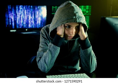 woman hacker looking worried at pc screen
