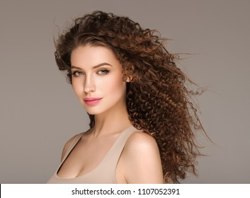 Woman hair long curly and perfect hairstyle female beauty portrait