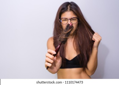 Woman with hair loss holding comb. Young girl losing  hair problem, falling hair on brush healthy medical treatment concept.