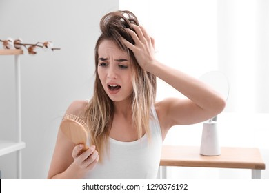 Woman with hair loss problem at home
