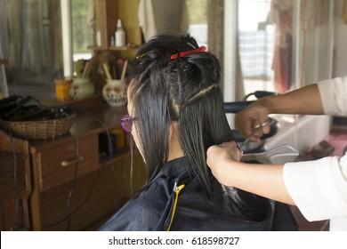 Woman in hair salon doing her hair style.
