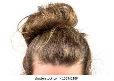 Woman hair tied in a bun.