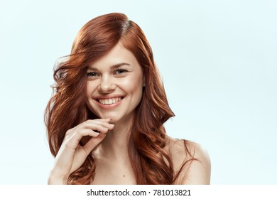 woman with a hairdress on a light background, beauty