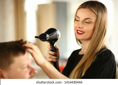 Woman Hairdresser Drying Male Hair with Hairdryer. Young Hairstylist Styling Haircut for Man with Dryer. Female Stylist Blowing on Client for Making Hairdo. Beautician Using Blowdryer for Hairstyle