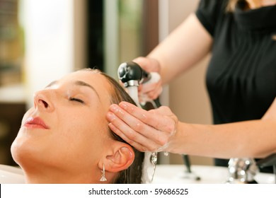 Woman at the hairdresser getting her hair washed and rinsed feeling visibly well