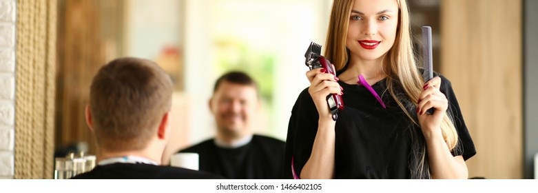 Woman Hairdresser Showing Razor and Comb to Client. Female Hairstylist Holding Electric Shaver and Hairbrush for Styling Male Haircut. Professional Stylist Using Shave for Hairdo in Salon