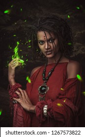 Woman with hairstyle dreadlocks and red clothes and green fire from her hand