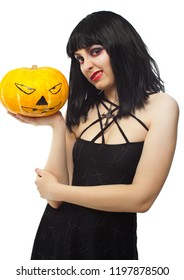 Woman in halloween look holding halloween pumpkin isolated on white. Witch isolated on white.