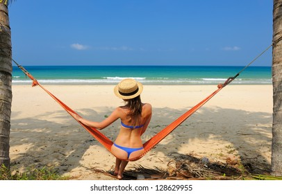 Woman in hammock on tropical beach at Tioman island, Malaysia