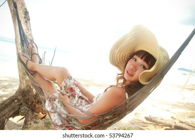 woman hammock sleep on the beach in Thailand.