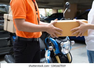 Woman hand accepting a delivery of boxes from deliveryman, Deliver goods by motorcycle service, Fast and Free Transport