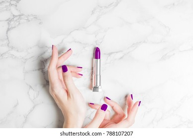 woman hand with beautiful purple ultra violet nail lipstick cosmetic minimal modern stylish