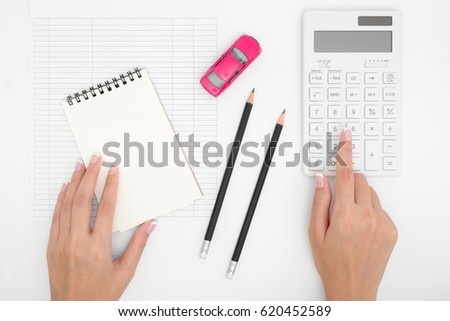 woman hand calculating car expenses payments stock photo edit now