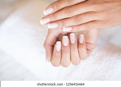 Woman Hand Care. Closeup Of Beautiful Female Hands Having Spa Manicure At Beauty Salon. Beautician Filing Clients Healthy Natural Nails With Nail File. Nail Treatment.