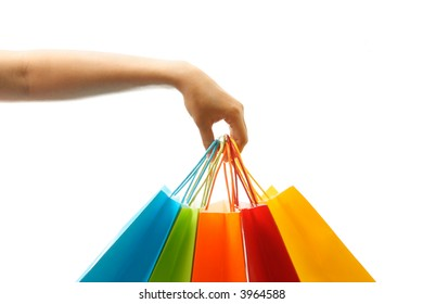 A woman hand carrying a bunch of shopping bags