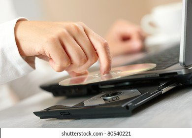 Woman hand with CD