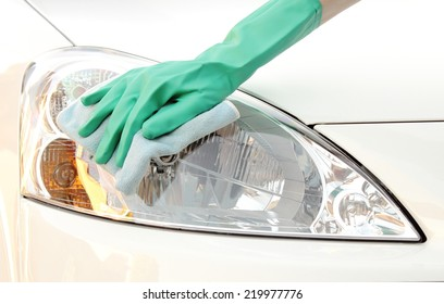Woman hand cleaning car using microfiber cloth