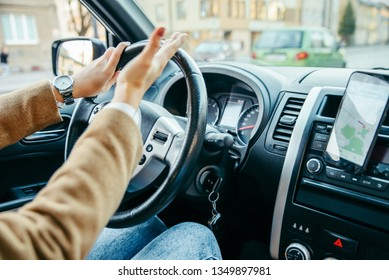 woman hand close up driving. stuck in traffic. navigation on the phone. lifestyle