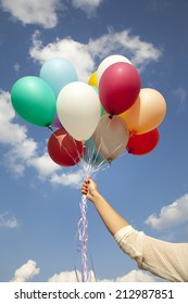 woman hand with colorful balloons