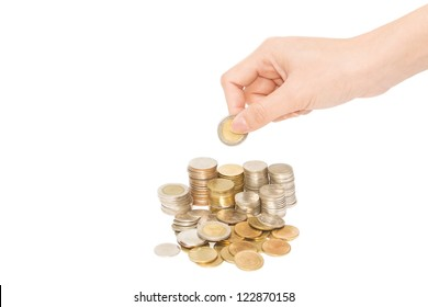 Woman hand with Columns of  coins on white background