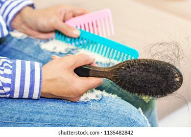 Woman hand with comb close up