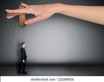 Woman hand control business man