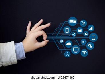 Woman hand with diagramms and business icons