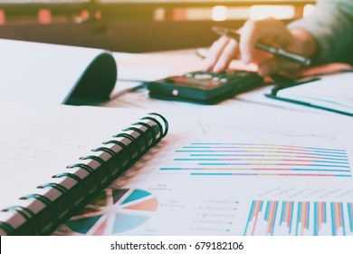 Woman hand doing calculate finance with paperwork on desk and th