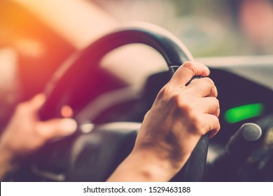 Woman hand driving car. Vintage filter