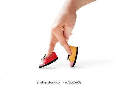 woman hand finger walking with colour shoe isolated on white background concept