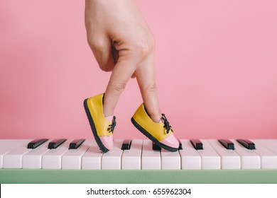woman hand finger walking on piano with shoe concept