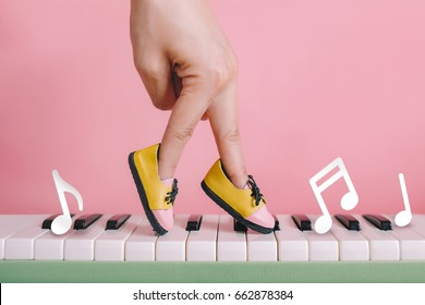 woman hand finger walking on piano between music note with shoe concept, Music lesson school education concept, Dance exercise for good healthy.