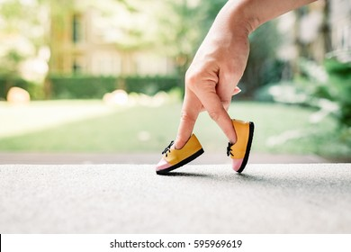 woman hand finger walking with shoe concept, Traveler adventure outdoor summer vacations concept, Healthy lifestyle concept. Stay at home quarantine for coronavirus.