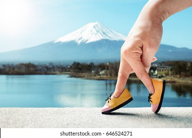 woman hand finger walking with shoe travel Japan concept ,Tourist Japan advertising, Traveler adventure outdoor summer vacations concept,  Healthy lifestyle concept