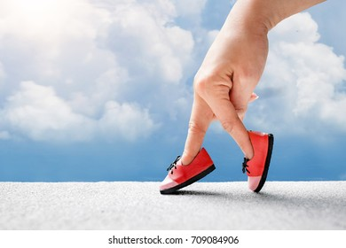 woman hand finger walking with shoe concept, Walking on sky