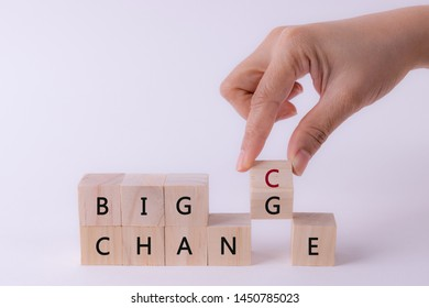 Woman hand flip wooden cube with word change to chance, Personal development or change yourself concept.