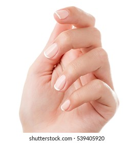 Woman hand with french manicure isolated on white background. Close-up. Retouched.