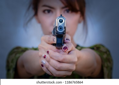 Woman with hand gun 9 mm.