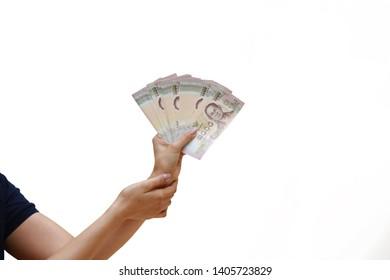 Woman hand handle or hold cash Thai Baht, Thai baht cash on hand